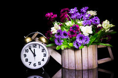 Still life with vintage clock with flower Stock Images