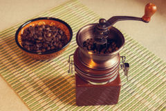 Still life with vintage coffee mill Stock Photo