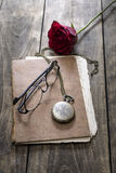 Still life with vintage notebook and rose Royalty Free Stock Images
