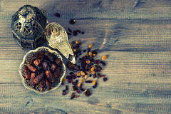 Still life with vintage orintal lantern, raisins and dates Stock Image