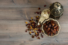 Still life with vintage orintal latern, raisins and dates Royalty Free Stock Photo