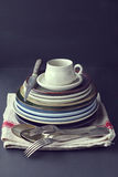 Still life with vintage plates and spoons-vintage effect added Royalty Free Stock Photography