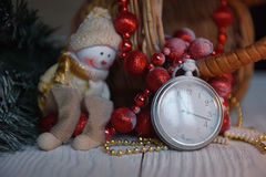 Still life vintage pocket clock on the background of Christmas ornaments, burning candles and fir branches Royalty Free Stock Photography
