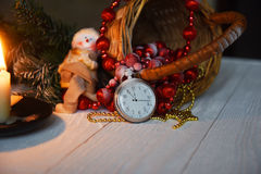 Still life vintage pocket clock on the background of Christmas ornaments, burning candles and fir branches Stock Photo
