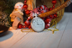 Still life vintage pocket clock on the background of Christmas ornaments, burning candles and fir branches Stock Photography