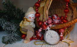 Still life vintage pocket clock on the background of Christmas ornaments, burning candles and fir branches Royalty Free Stock Images