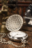 Still life with vintage pocket watch close-up Stock Image