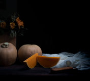 Still life, vintage. pumpkin and orange roses on a dark wooden table. art, old paintings Stock Images