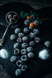 Still life in style. Close up frozen berry of blackberry with spoon and sugar on black stone stand. Top view. Still life in vintage style. Close up frozen berry royalty free stock photography