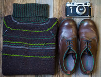Still life with Vintage sweater. Vintage sweater, shoes, antique rangefinder camera on old rough boards. still life in retro style Stock Photo