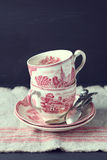 Still life with vintage teacups and spoons Royalty Free Stock Photo