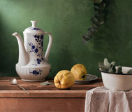 Still life with vintage teapot, quince and enamel Stock Photography