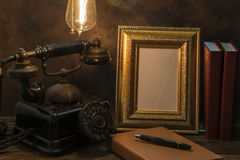 Still life of vintage telephone with picture frame and diary on Royalty Free Stock Photography