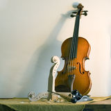 Still life with violin. A violin in workshop Stock Photos