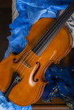 Still life with violin. Cremonese violin in a still life composition Stock Photo