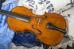 Still life with violin. Cremonese violin in a still life composition Royalty Free Stock Image