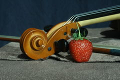 Still life with violin and strawberry Royalty Free Stock Image