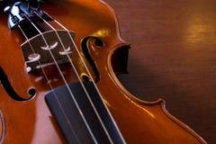 Still life violin on wood table. Royalty Free Stock Image