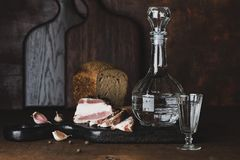 Still life with vodka, bread and lard. Still life with vodka, bread and bacon in Russian style royalty free stock photo