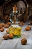 Still life with walnut oil Stock Image