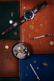 Still life. Watches and mechanisms Stock Photos
