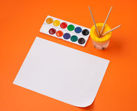 Still life with watercolour and empty paper sheet Stock Photos
