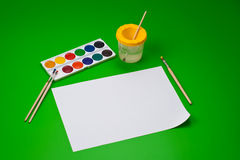 Still life with watercolour and empty paper sheet Stock Images