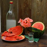 Still life with watermelon. Slices and chilled alcoholic beverage stock photos