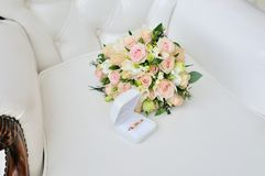 Still life with wedding bouquet and rings. Still life with wedding bouquet and wedding rings Stock Photos