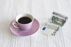 Cup of coffee and 5 euro note. Still life on white background of Cup of coffee and 5 euro note stock images