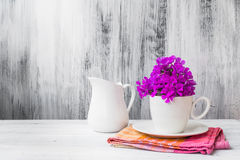 Still life white china flowers. Still life with white china and flowers stock images