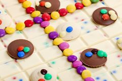 Still life of white chocolate with smarties. Inside, indoors, interiors, food, nutrition, nourishment, milk, bar, candy, confections, confectionery, sweet stock photography