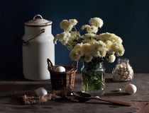 Still life with white chrysanthemums and white a c Stock Photos