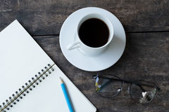Still life with White cup of hot coffee , white notebook ,pencil Stock Image