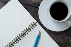 Still life with White cup of hot coffee , white notebook Royalty Free Stock Images