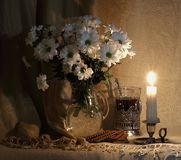Still life. white flowers in a glass decanter stock photo