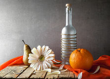 Still life white gerbera bottle fruits Stock Photo