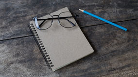 Still life white notebook ,pencil and glasses Stock Image
