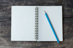 Still life with white notebook and pencil Stock Images