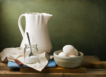 Still life with white pitcher and eggs Royalty Free Stock Photos