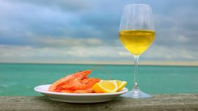 Still life of plate with shrimps, lemon and wine stock footage
