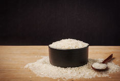 Still life white rice in black bowl on wooden background Stock Image