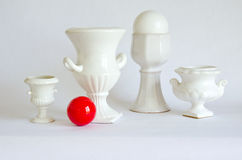 Still-life with white vases and red billiards ball Royalty Free Stock Images