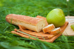 Still life with white wine, baguette, cheese, grape and apple Royalty Free Stock Photos