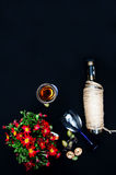 The still life with white wine in glass bottle on black background. Glasses of wine with fresh grapes. Bottle and footed glass. Fr Royalty Free Stock Photos