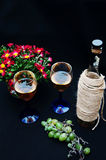 The still life with white wine in glass bottle on black background. Glasses of wine with fresh grapes. Bottle and footed glass. Fr Royalty Free Stock Photo
