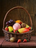Still life wicker basket with fruit Royalty Free Stock Image