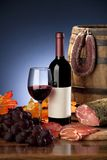 Still life with wine. Grapes and meat royalty free stock photography