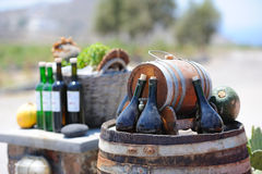 Still-life with wine bottles and barrels Royalty Free Stock Images