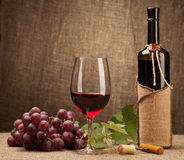 Still life with wine bottles, glasses and grapes.  stock photos